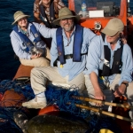 Mary Lou Mate, Ladd Irvine, Bruce Mate, and Ken Brower with sea turtle disentangled from abandoned fishing gear at the Costa Rica Dome