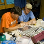 Ladd Irvine helps Ken Brower process the days biopsy samples collected from blue whales at the Costa Rica Dome