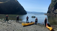The Port Orford gray whale research team, composed on high school, undergrads and graduate students, wraps up their kayak training session.