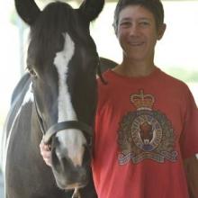 Beth Slikas standing next to a horse
